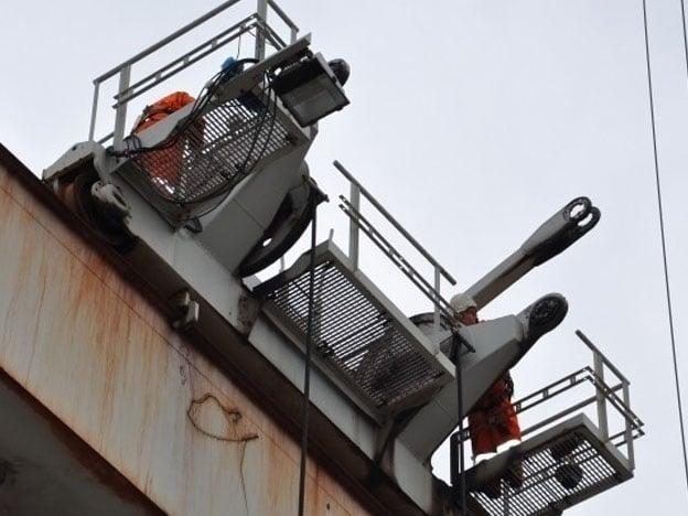 Reparatie automatische stapelkraan van Nelcon